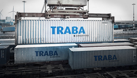 Traba Logistics containers being stacked by machine
