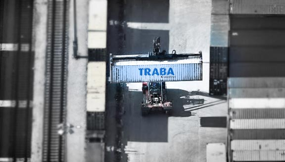 Traba Logistics container being transported by vehicle.